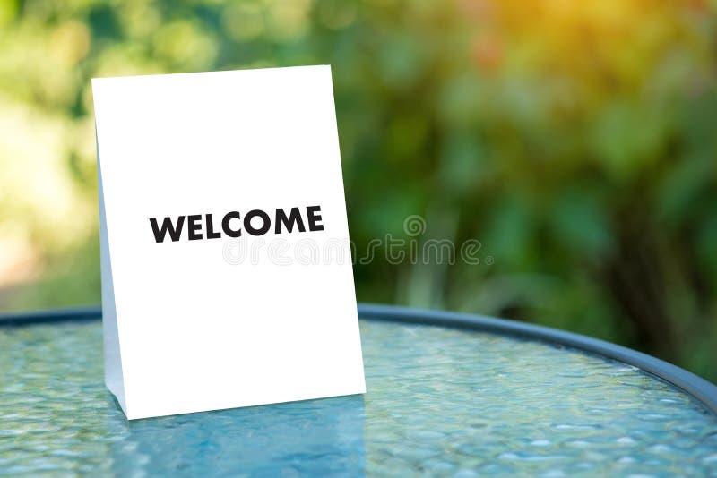 Öppen välkomnande för VÄLKOMMEN begreppskommunikationsaffär till laget arkivbilder