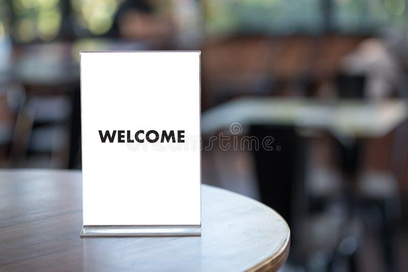 Öppen välkomnande för VÄLKOMMEN begreppskommunikationsaffär till laget arkivfoto