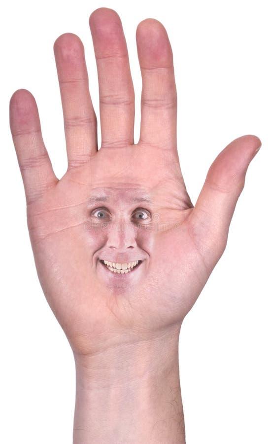 Öppna handen med lyckligt leende, den le framsidan som isoleras royaltyfri foto