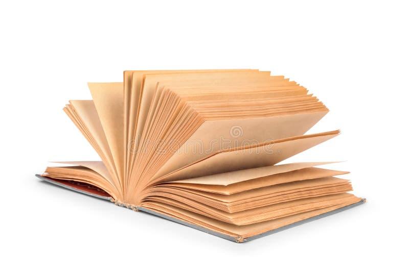 Öppna isolerade listor för den gamla boken av sidor på flyttning royaltyfria bilder