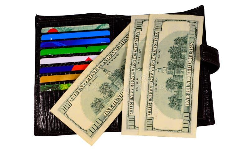 Öppna plånboken med pengar och kreditkortar som isoleras på vit royaltyfria foton