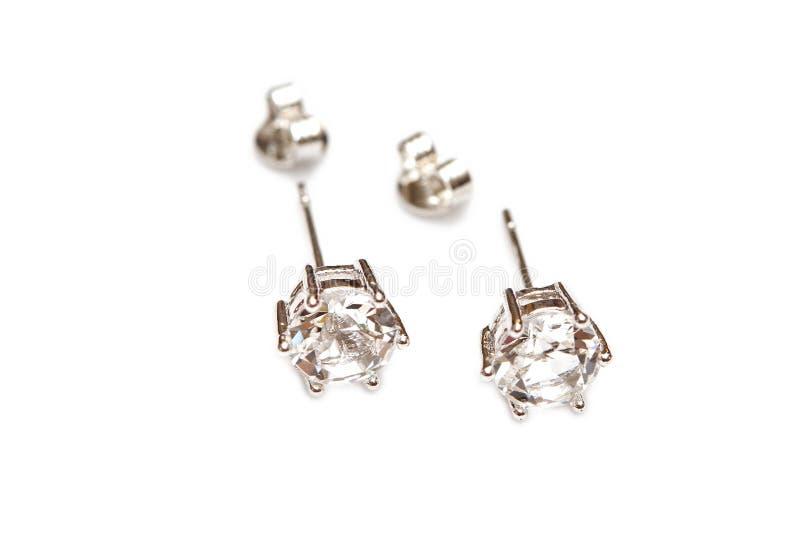 Örat ringer med diamanter royaltyfri foto