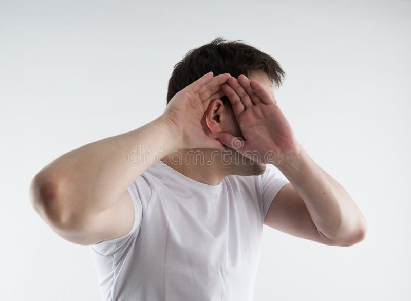 Örat smärtar arkivfoto