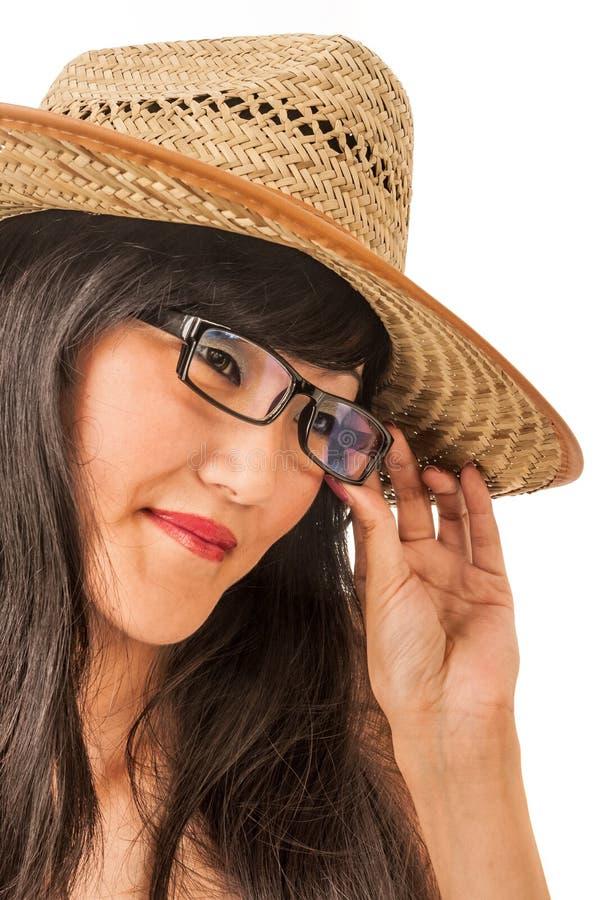 Östlig kvinnlig i en hatt och exponeringsglas royaltyfria bilder