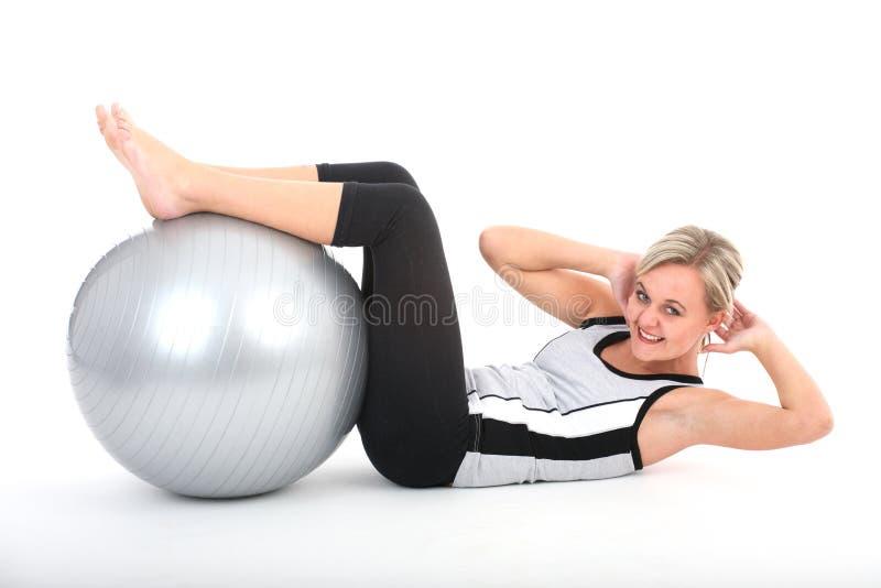 öva idrottshalldräktkvinnan royaltyfri foto