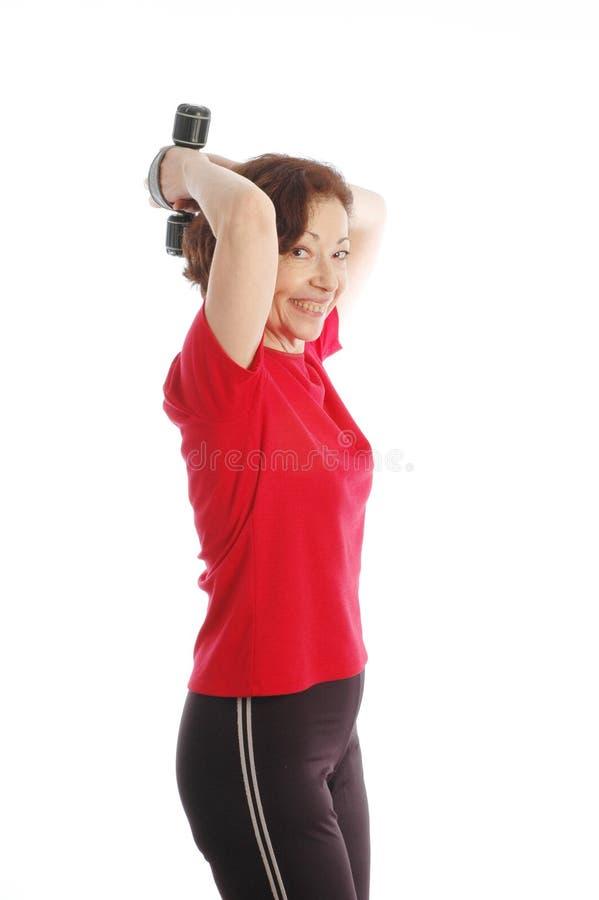 Download öva kvinnan arkivfoto. Bild av övning, triceps, utbildning - 502834