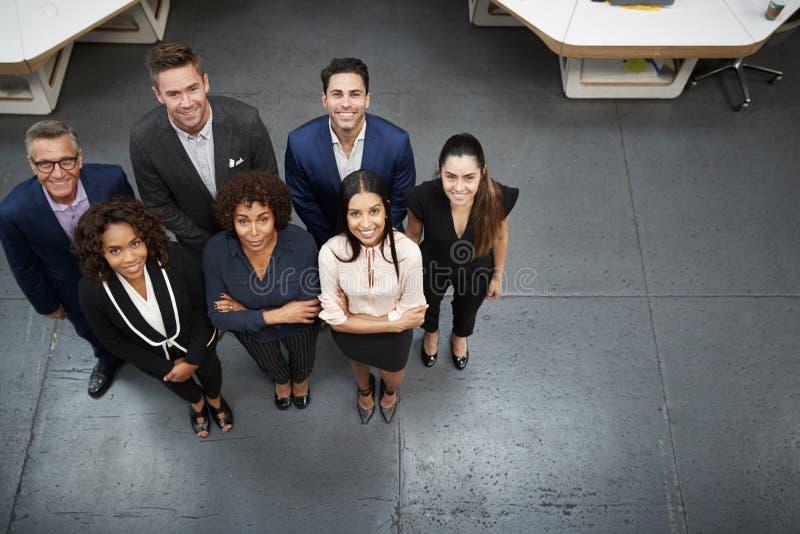 Över huvudet stående av affären Team Standing In Modern Office fotografering för bildbyråer