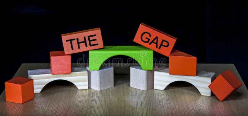 Överbrygga Gap - affären, utbildning, PR, politik - arkivfoton