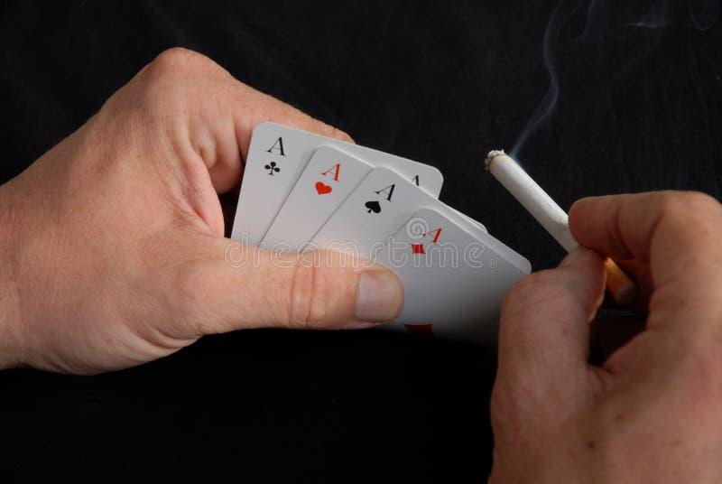 överdängare cards fyra som leker arkivfoton