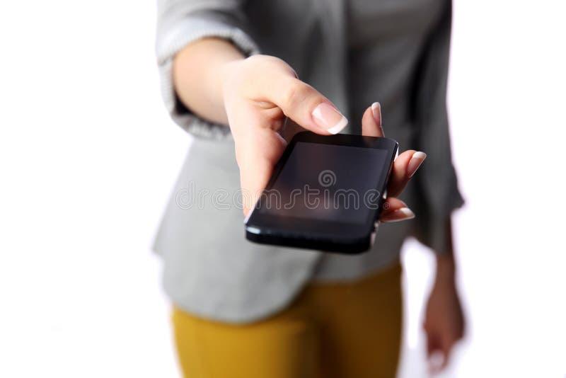 Övergående smartphone för kvinna till dig arkivbilder