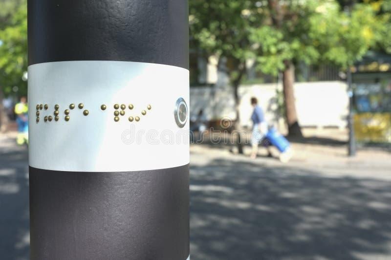 Övergångsställe trafikpol för blint folk fotografering för bildbyråer