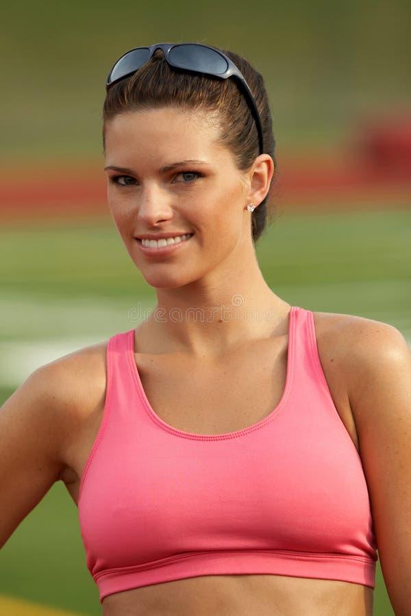 överkant för idrottsman nenkvinnligpink royaltyfri foto