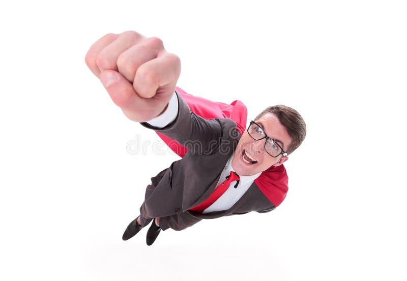 Överkant målmedveten superhjälte affärsman som reser sig upp arkivfoton