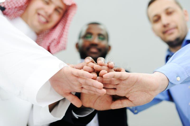 Överlappande händer för affärslag royaltyfri bild