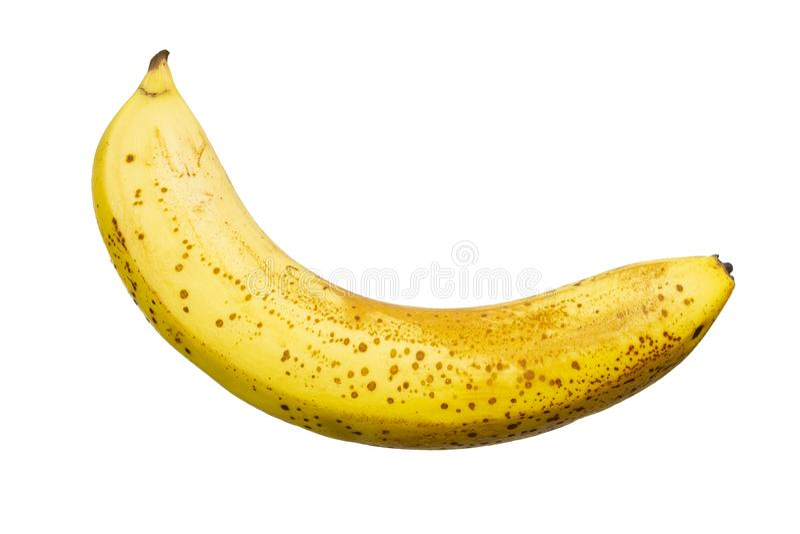 ?vermogen guling f?r banan med fl?ckar p? en vit bakgrund, isolatn?rbild royaltyfria bilder