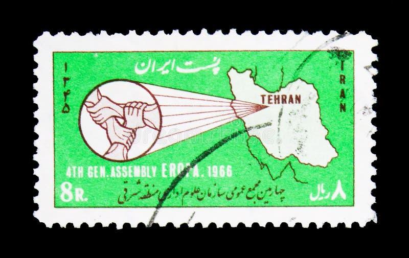 Översikt av Iran som gripa in i varandra händer, 4th möte av den offentliga adminen arkivbild