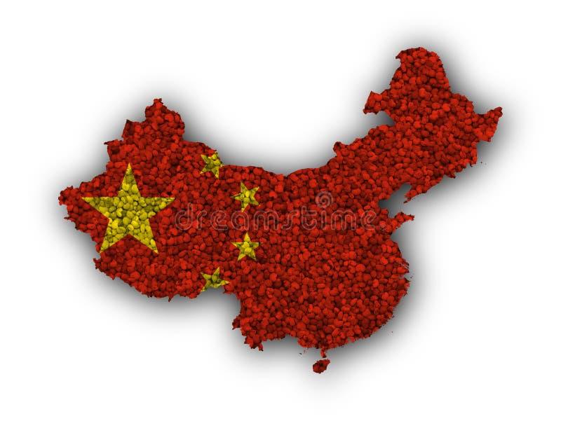 Översikt och flagga av Kina på vallmofrön royaltyfri foto