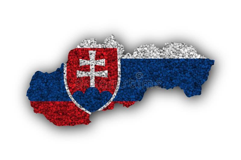 Översikt och flagga av Slovakien på vallmofrön arkivbilder