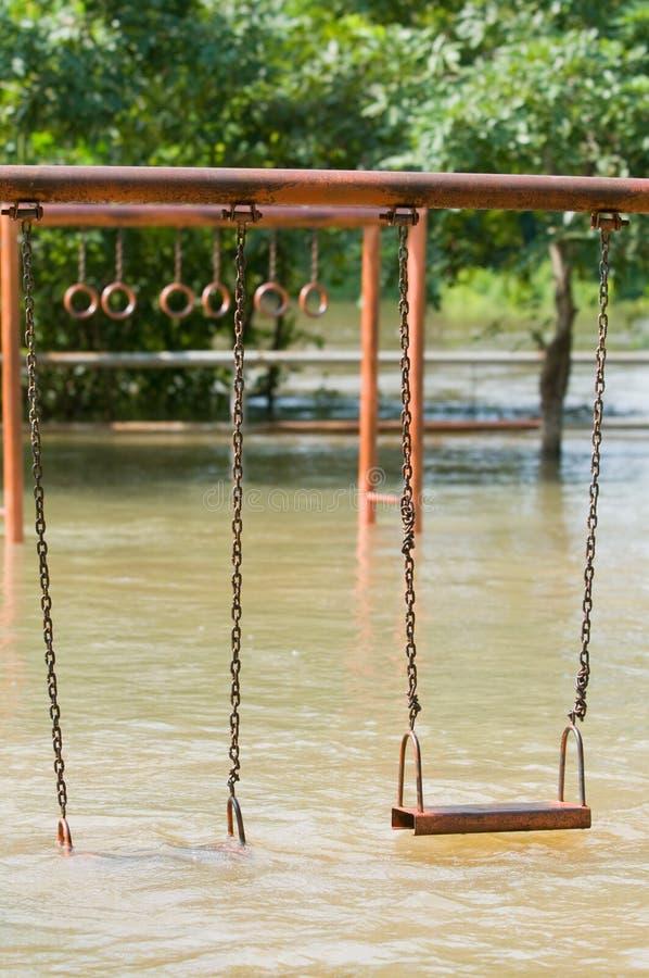 översvämmad lekplats royaltyfria bilder