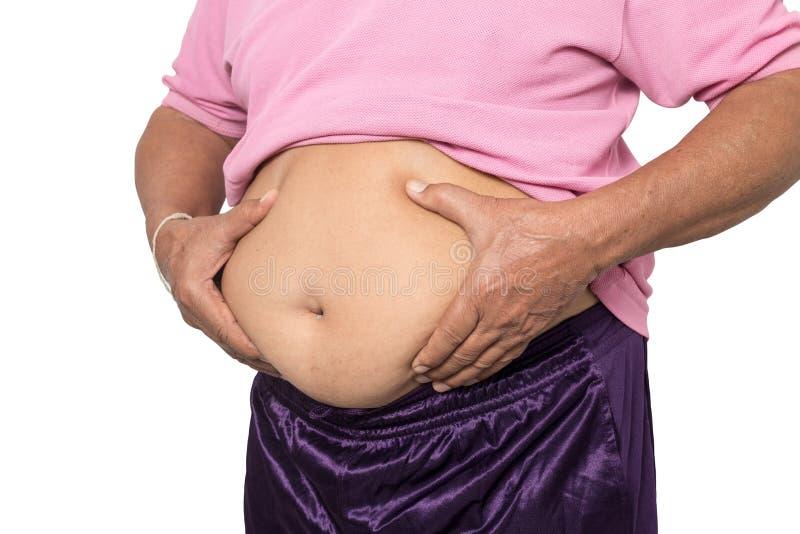 Överviktig manhand som klämmer den överdrivna buken fet royaltyfria foton