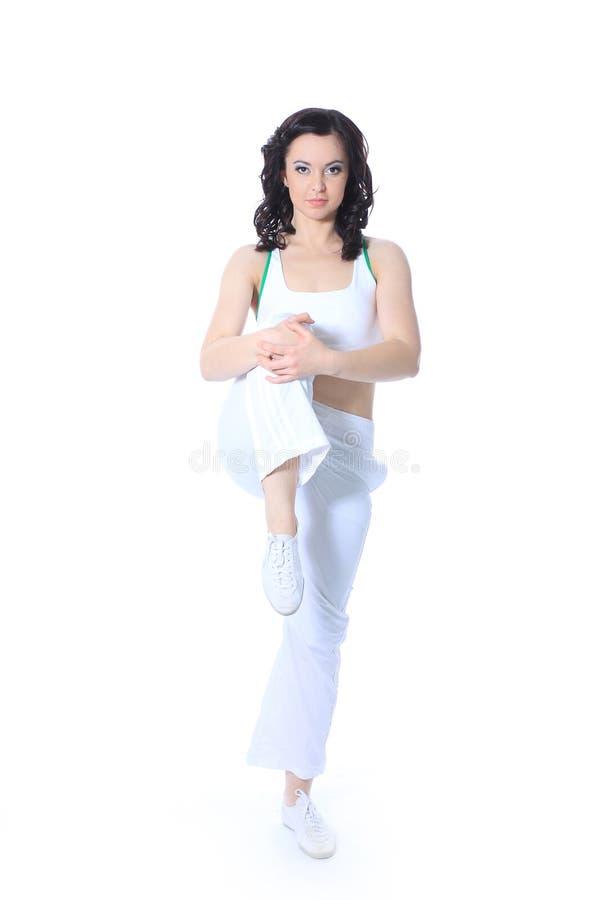 Övningar för konditioninstruktörshower bakgrund isolerad white royaltyfri foto