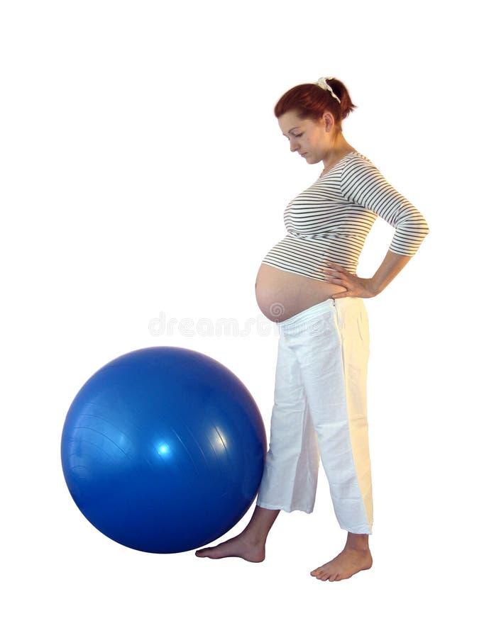 Download övningsgravid kvinna fotografering för bildbyråer. Bild av övning - 995389