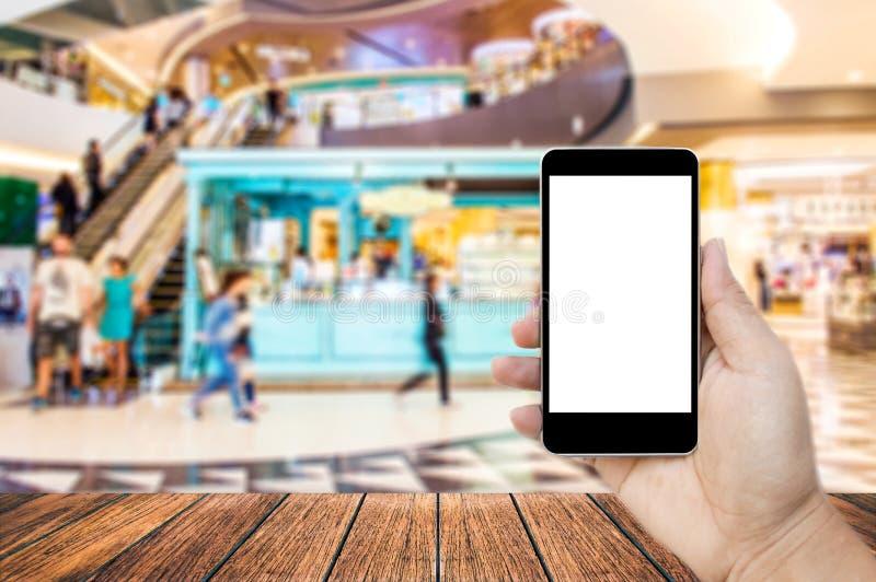 Övre bild för åtlöje av mobiltelefonen för handinnehavsvart med den tomma vita skärmen arkivfoton