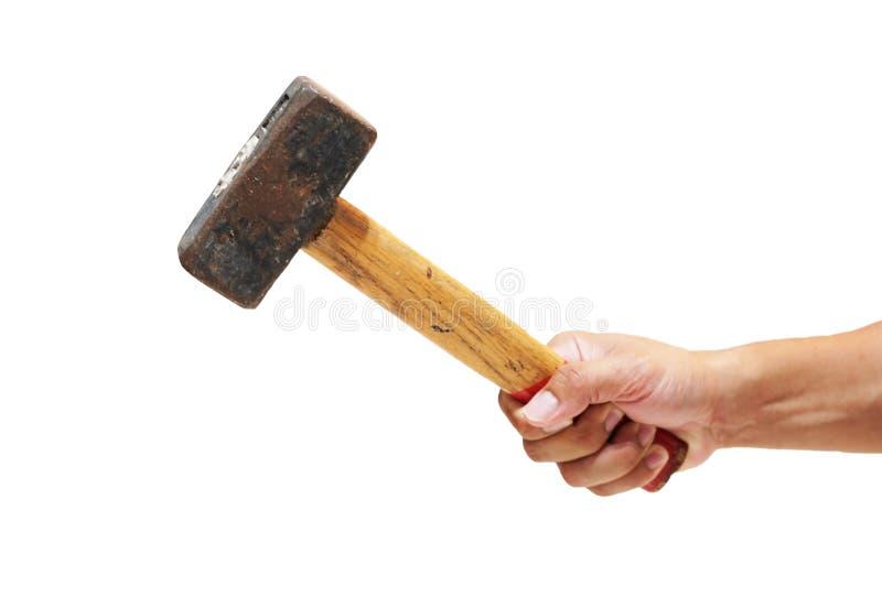 Övre hand för slut som rymmer en stor hammare arkivbild