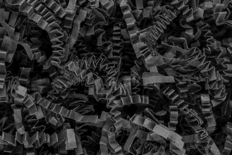 Övre sikt för slut av yttersida för bakgrund för pappers- remsor för låda för gruppdokumentförstöraresvart lockig arkivfoto