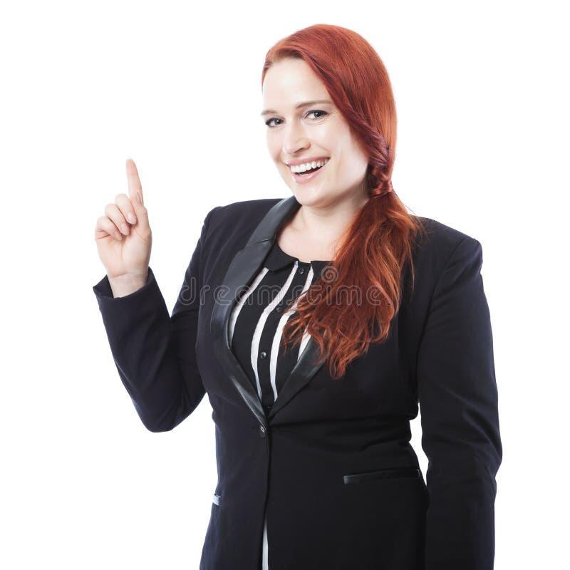 Övre ung punkt för affärskvinna och leenden fotografering för bildbyråer