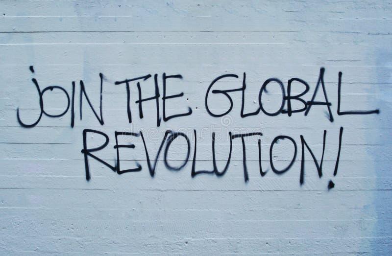 Únase a la revolución global escrita en la pared Mensaje, cita, concepto de la declaración fotografía de archivo libre de regalías