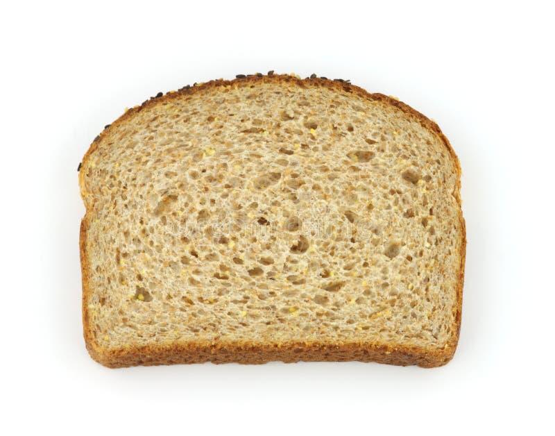 Única fatia de pão inteiro saudável da grão foto de stock royalty free
