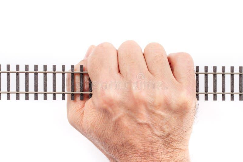 Único trilho em uma mão imagem de stock