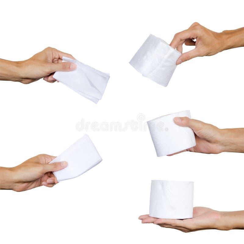 Übergeben Sie das Halten der Sammlung Serviette oder weißen Toilettenpapiers, die lokalisiert werden lizenzfreies stockbild