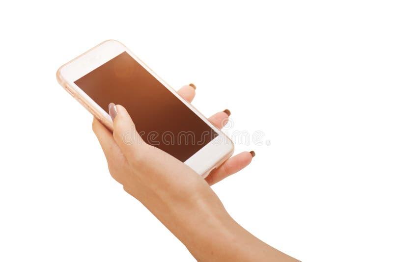 Übergeben Sie das Halten des großen mit Berührungseingabe Bildschirms intelligentes Telefon lokalisiert auf weißem Hintergrund mi lizenzfreies stockfoto