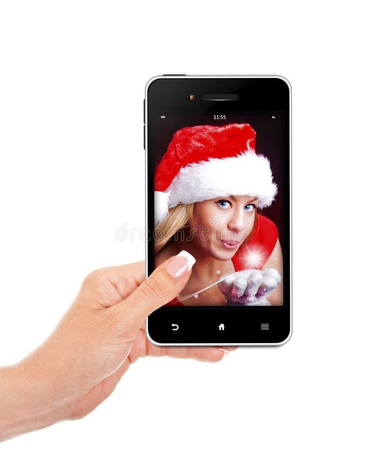 Übergeben Sie das Halten des Handys mit der Weihnachtsfrau, die über whi lokalisiert wird stockbild