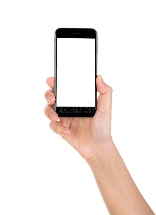 Übergeben Sie das Halten des intelligenten Mobiltelefons mit dem leeren Bildschirm, der auf wh lokalisiert wird lizenzfreies stockbild