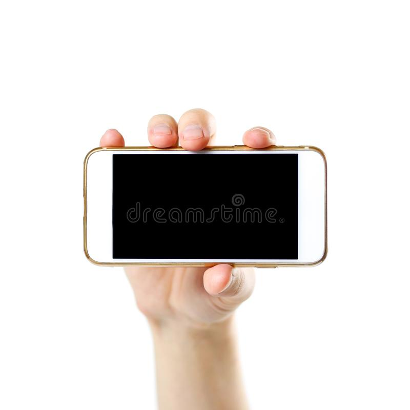 Übergeben Sie das Halten des weißen Telefons mit leerem schwarzem Schirm Abschluss oben Isolator lizenzfreies stockfoto