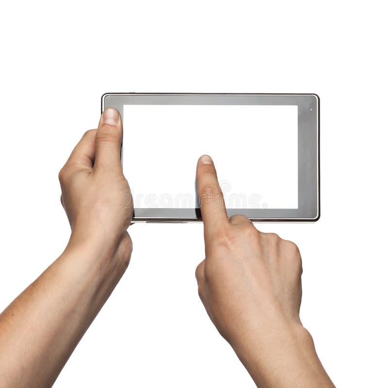 Hand, die Tablette PC lokalisiert auf Weiß hält stockfotos