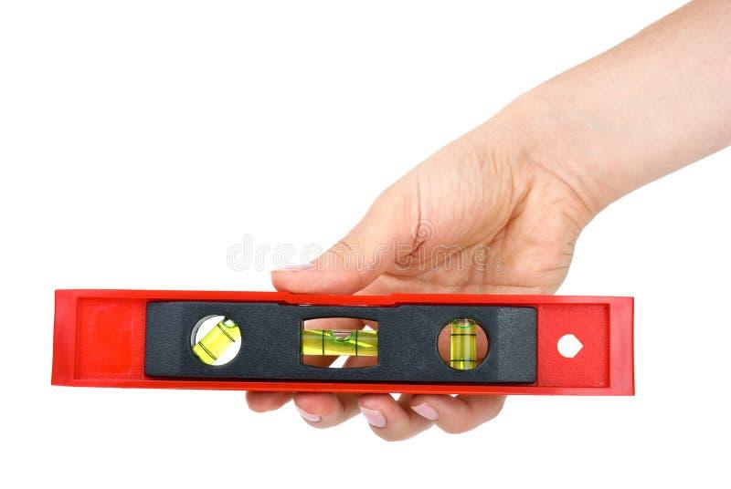 Übergeben Sie Holding kleines Klinometer stockfoto