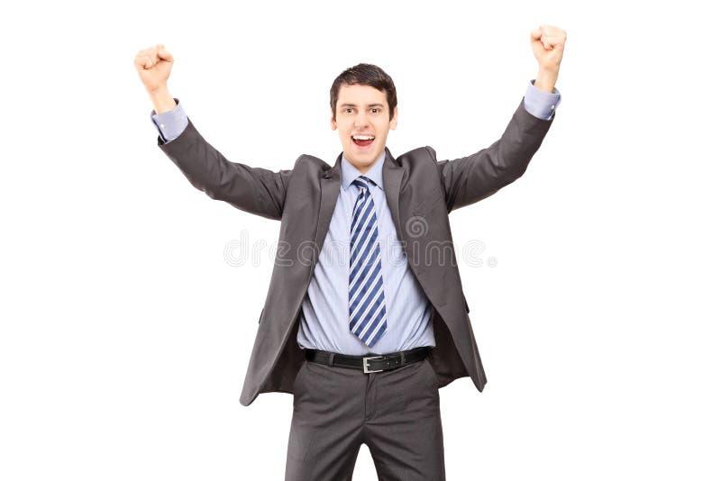 Überglücklicher Geschäftsmann, der mit den Händen gestikuliert stockfoto