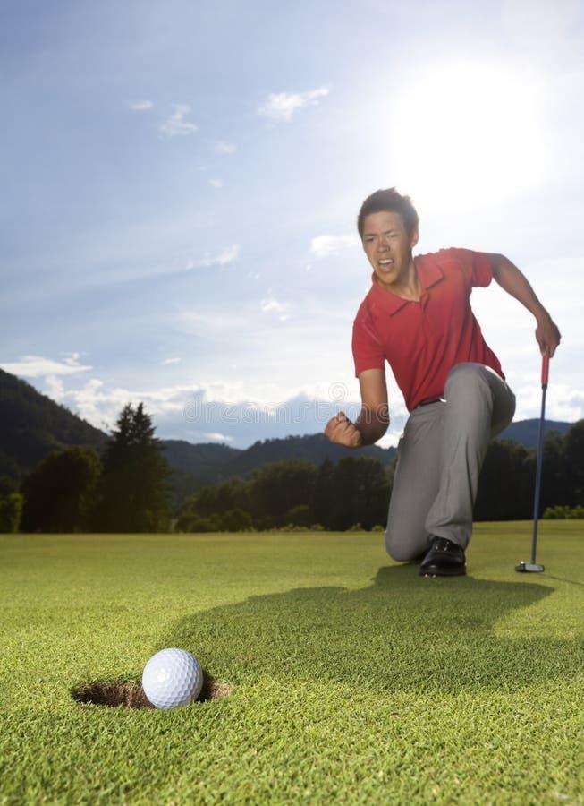 Überglücklicher Golfspieler. stockbild