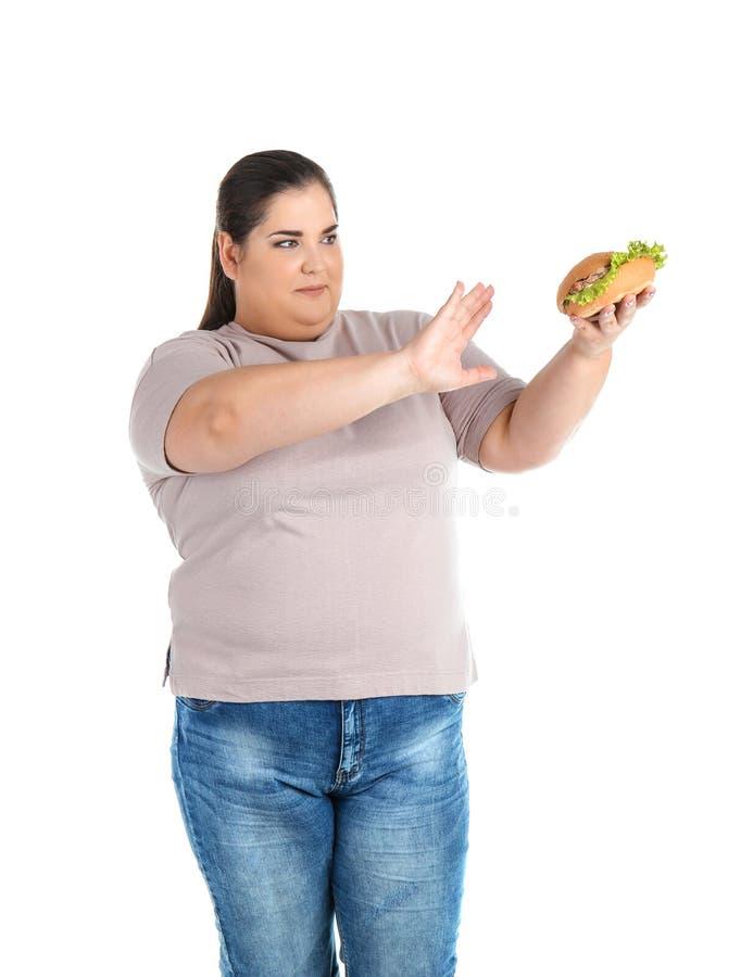 Überladene Frau mit Hamburger lizenzfreies stockfoto