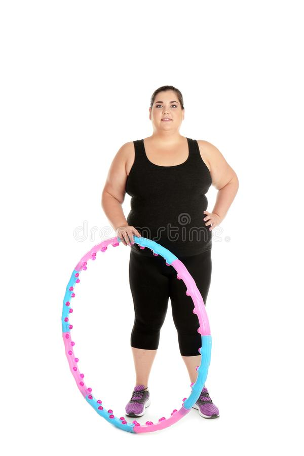 Überladene Frau mit hula Band stockbild