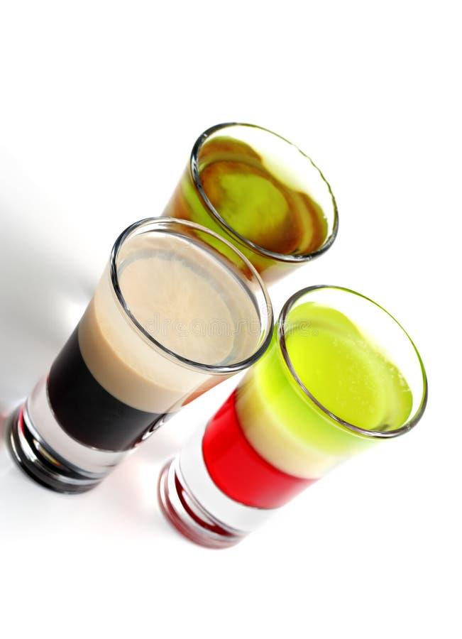 Überlagerte alkoholische Cocktails lizenzfreies stockfoto