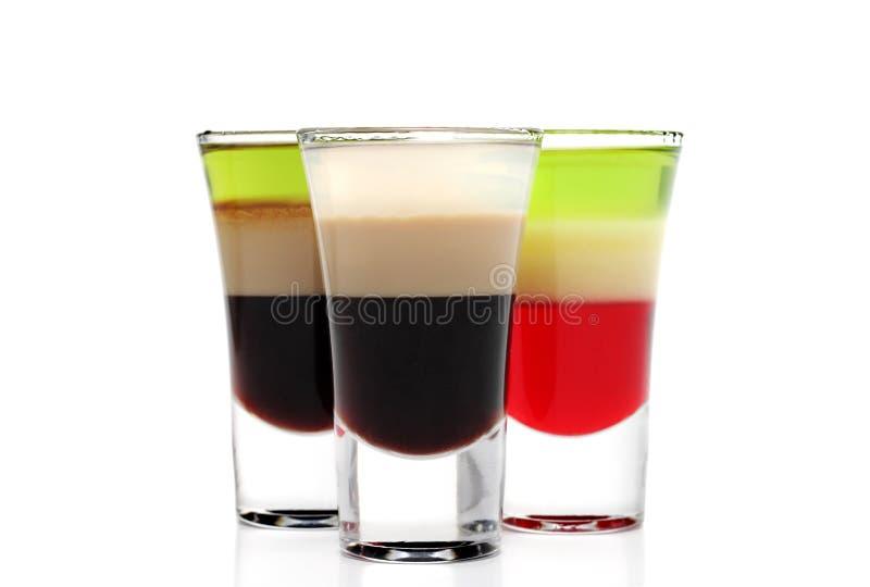 Überlagerte alkoholische Cocktails stockbild