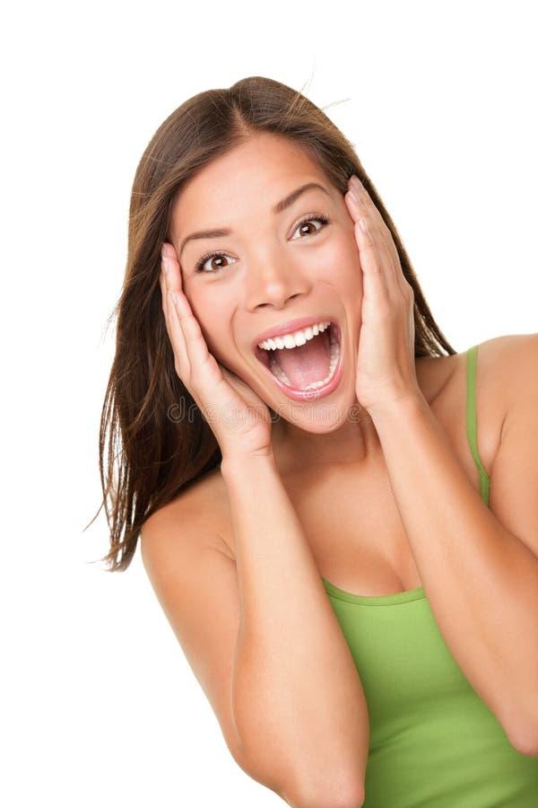 Überraschte aufgeregte Frau stockfotografie