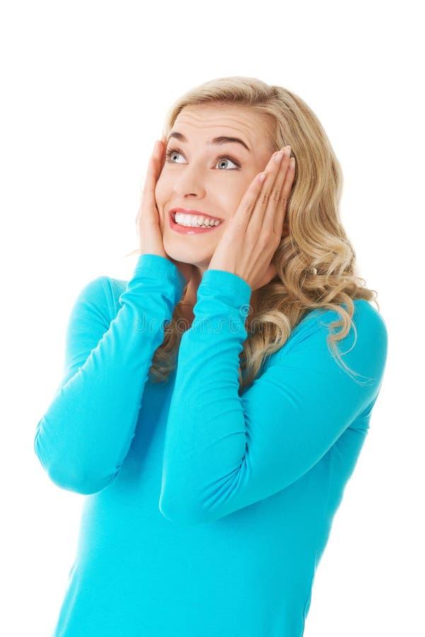Download Überraschte Frau Mit Den Händen Auf Kopf Stockfoto - Bild von schön, person: 47101442