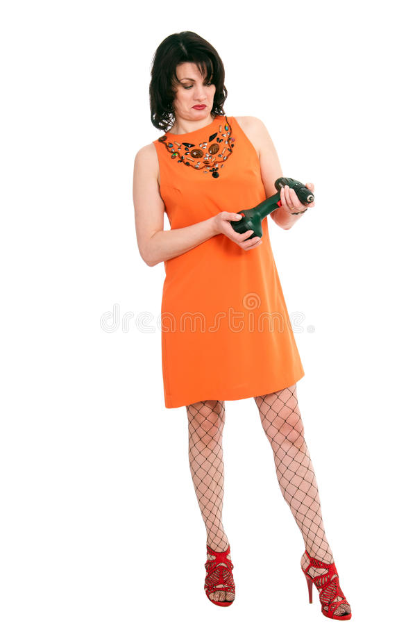 Überraschte Frau mit Schraubenzieher stockfoto