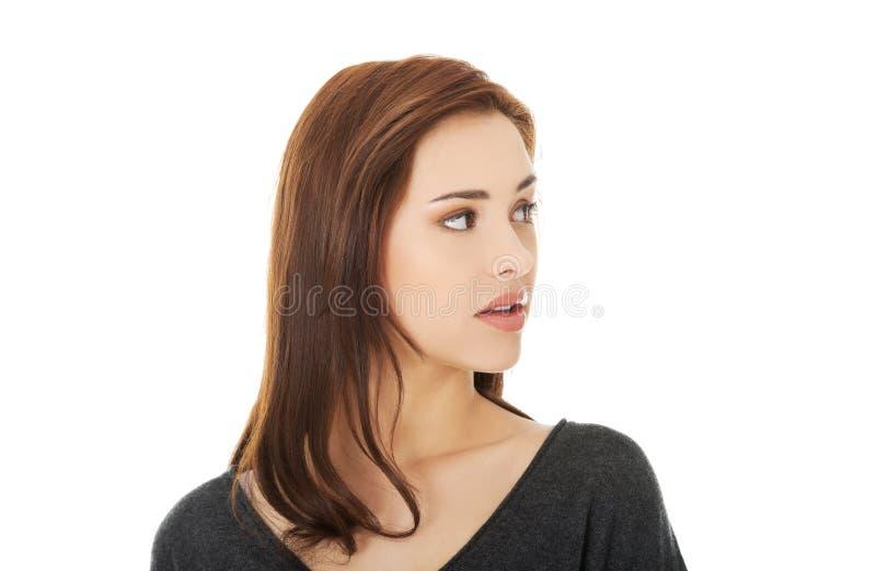 Überraschte junge Frau stockfotos